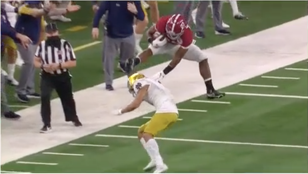 Najee Harris jumping over Notre Dame player